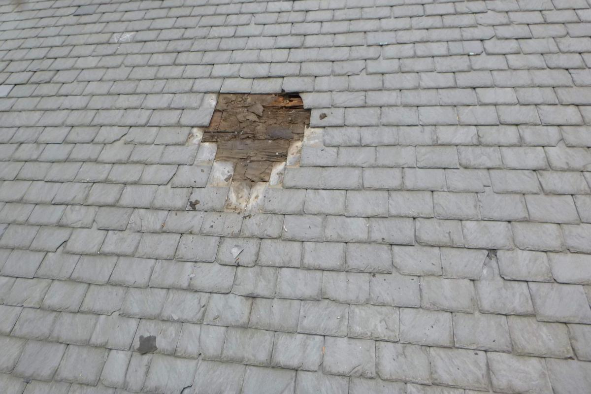 Deteriorated roof deck and felt at slate shingle test opening